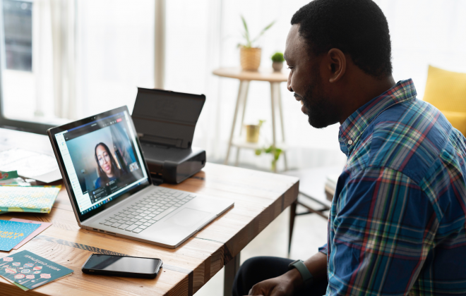 Two people communicating over virtual conferencing tools (E.g. Teams)